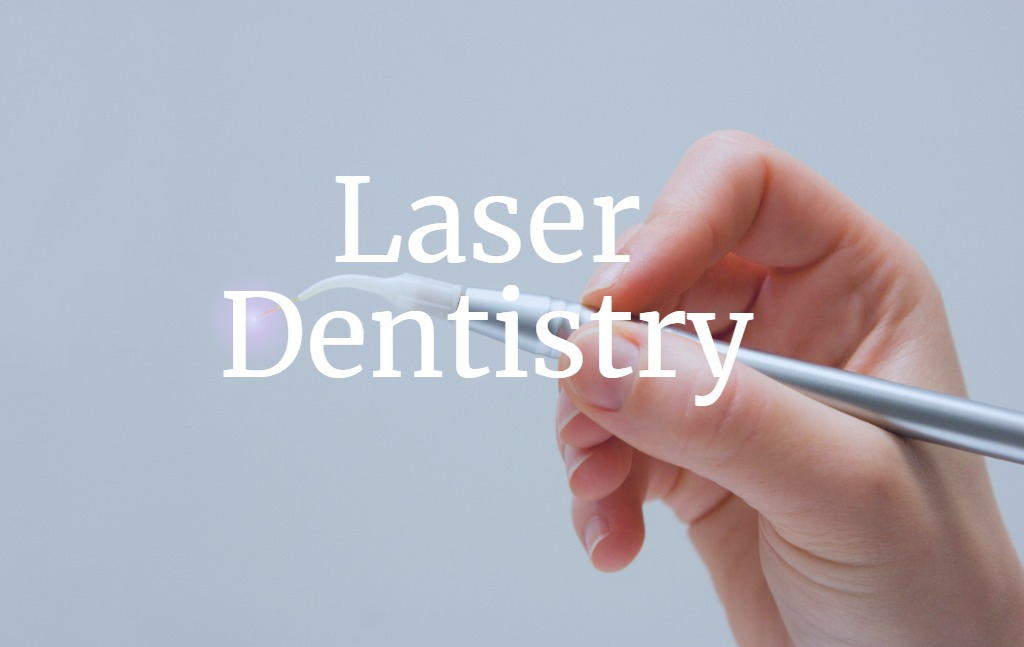 hand-with-dental-laser-system-picture-id154203434 (1).jpg