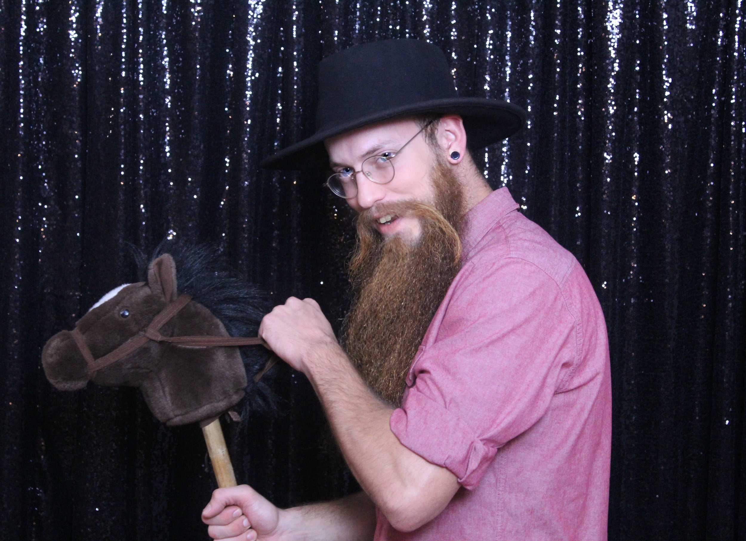 Glitter background and hobby horse prop
