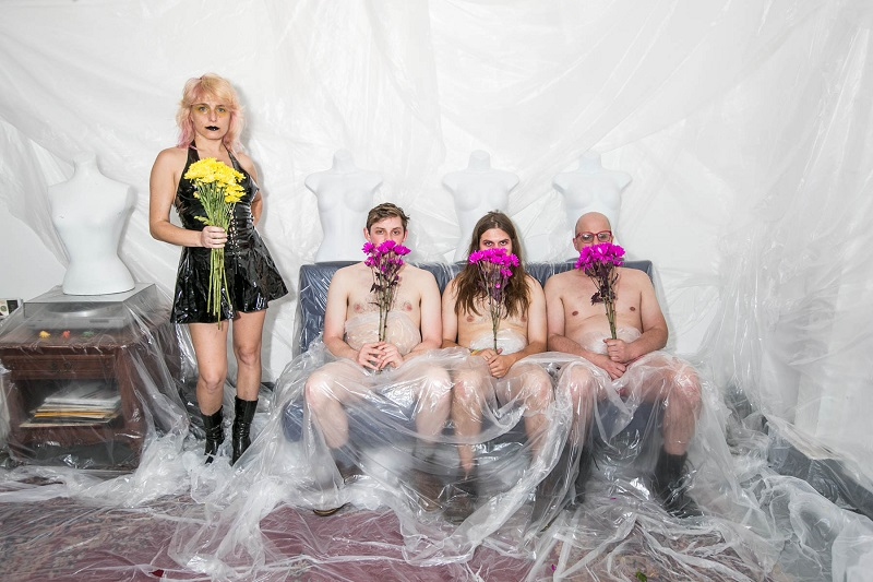 Everyone is Dirty dabbling with flowers and plastic; photographed by Ginger Fierstein.