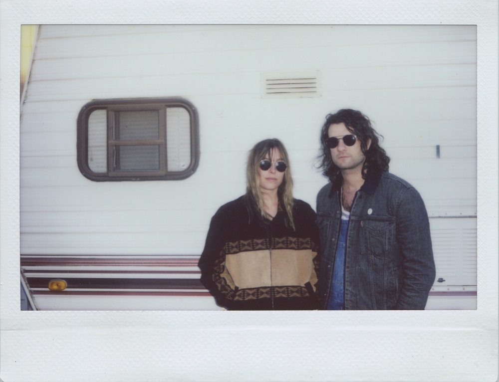 Melissa & Craig of Baybs looking cool by the camper; press photo courtesy of the artists.