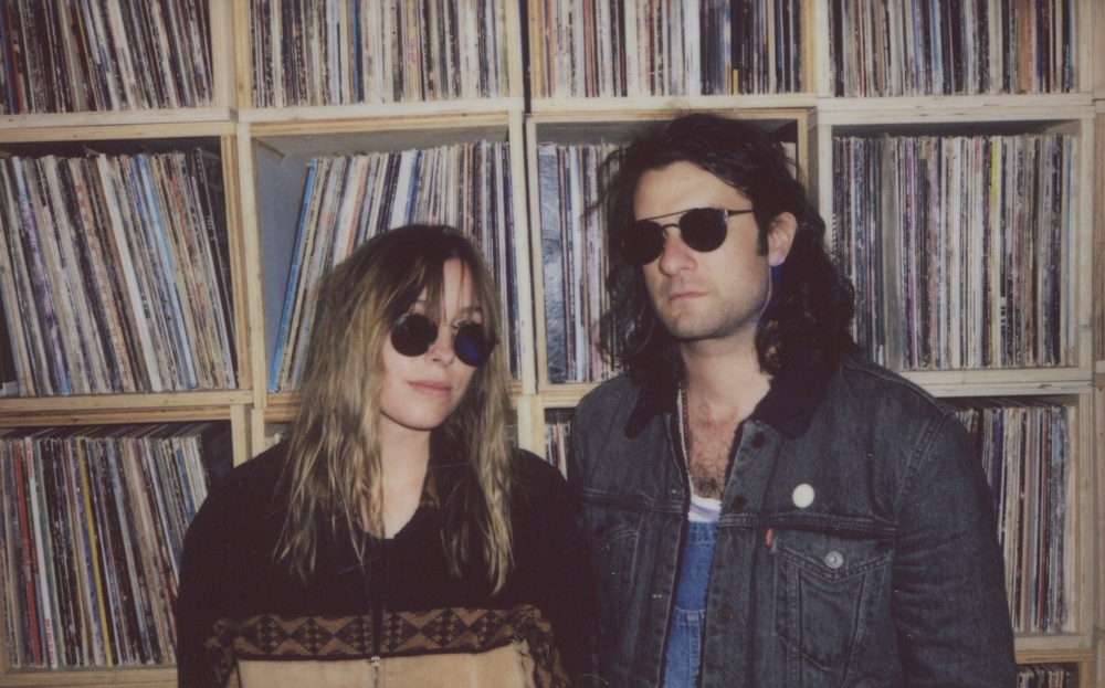 Looking cool by the record collection stacks with Baybs; press photo.