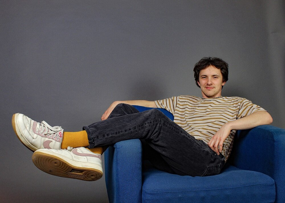 Kicking it on the comfy seat with New Love Crowd's Travis Swinford; press photo courtesy of Drew Price.