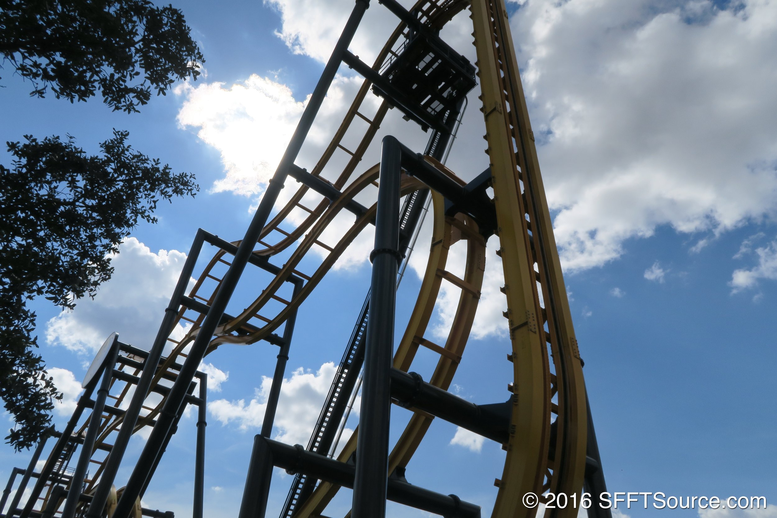 Riders ascend a vertical lift to the top.