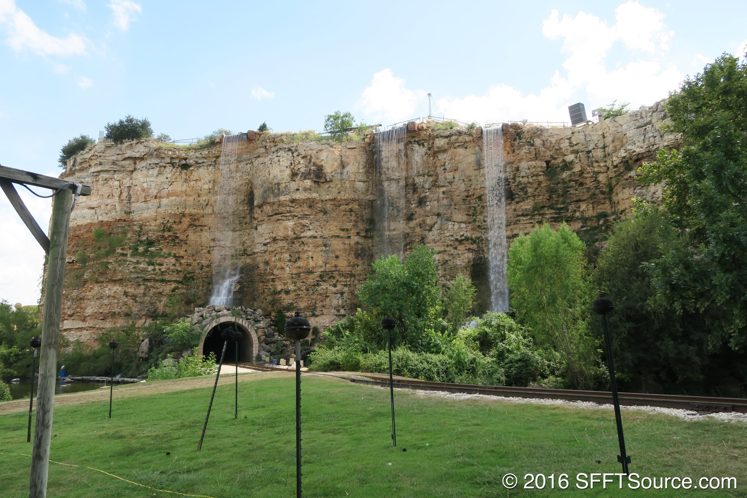The quarry wall with fountain features.