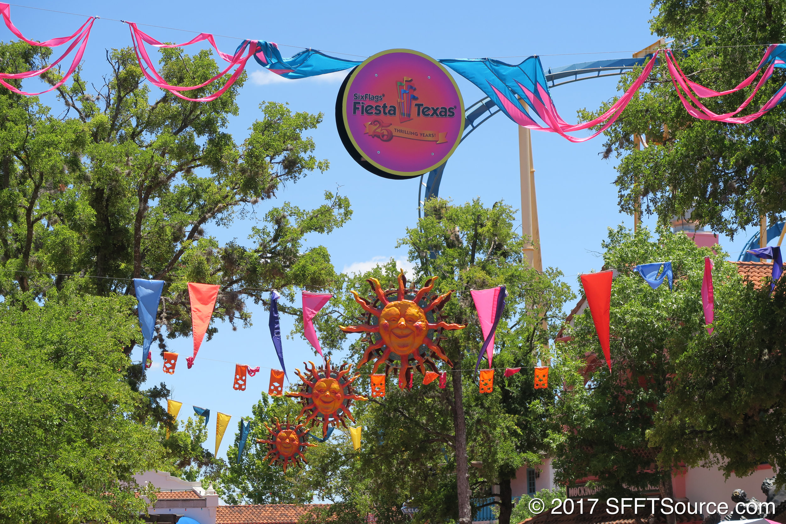 Banners hang above the pathways of Los Festivales.