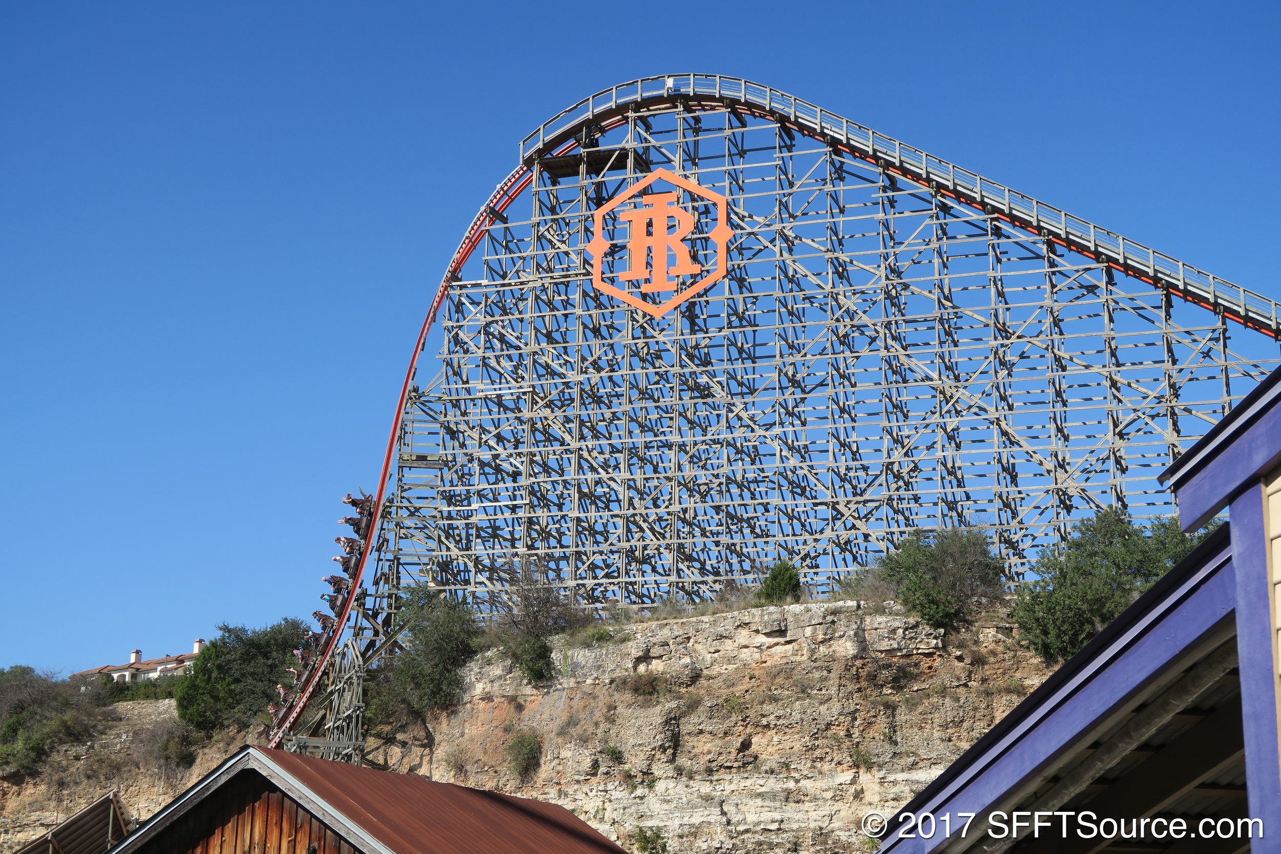 A train traveling down the ride's first drop.