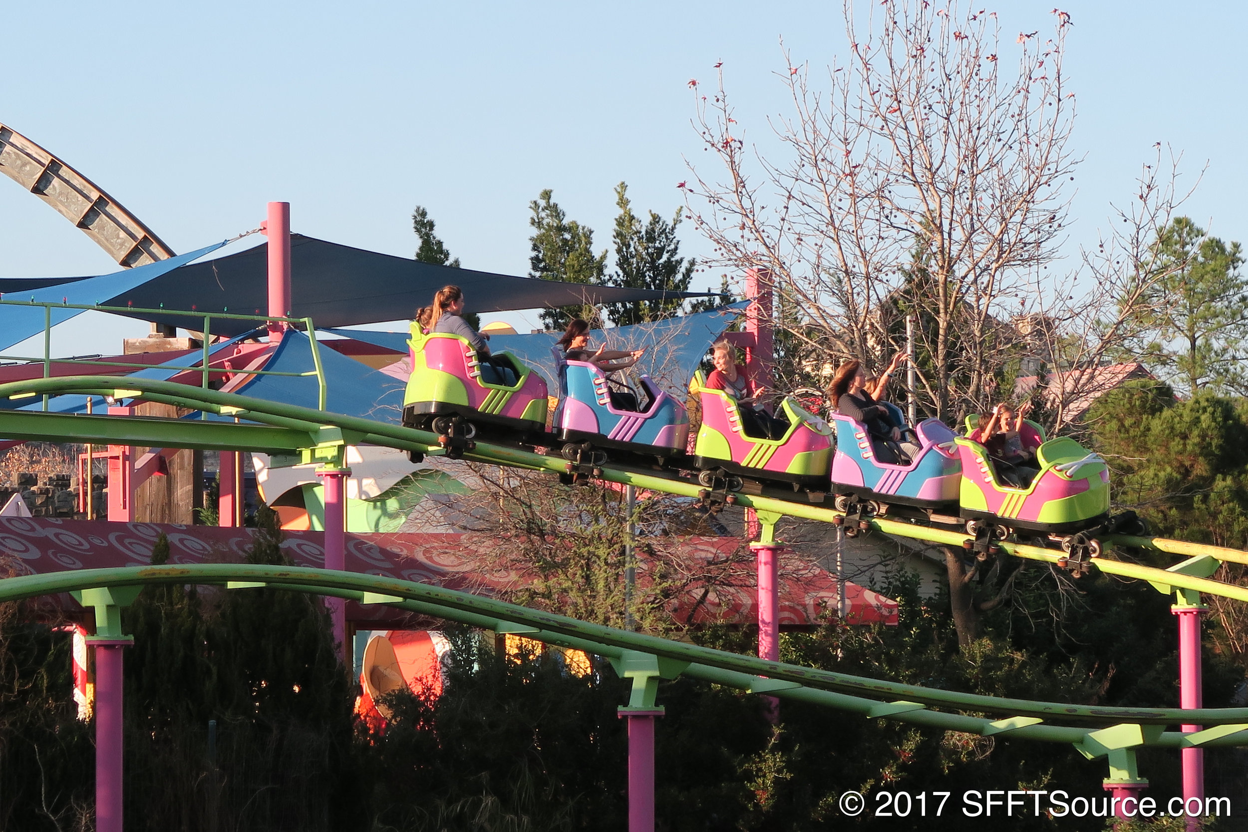 A train travels down the first drop.