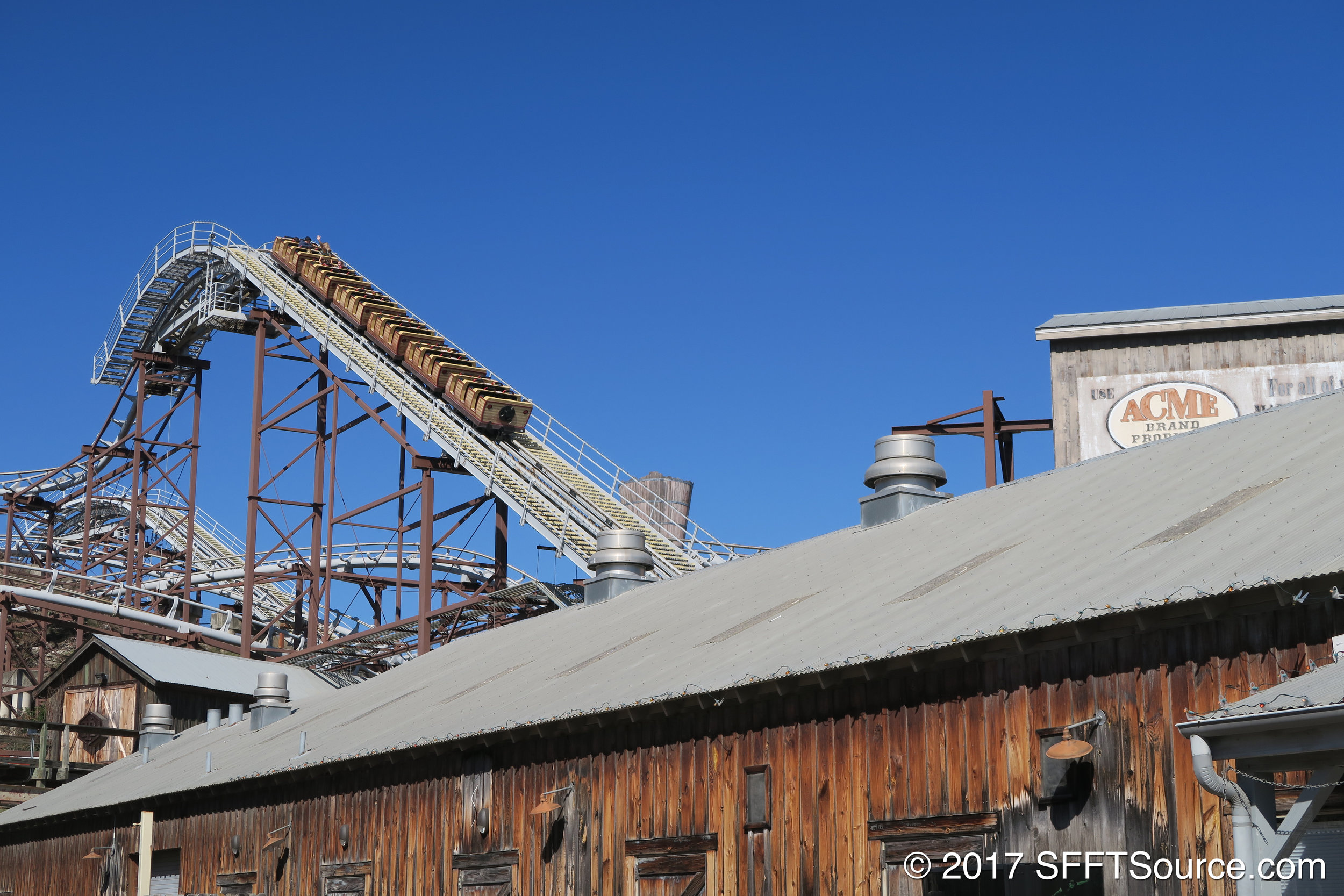 A train approaching the top of the lift hill.