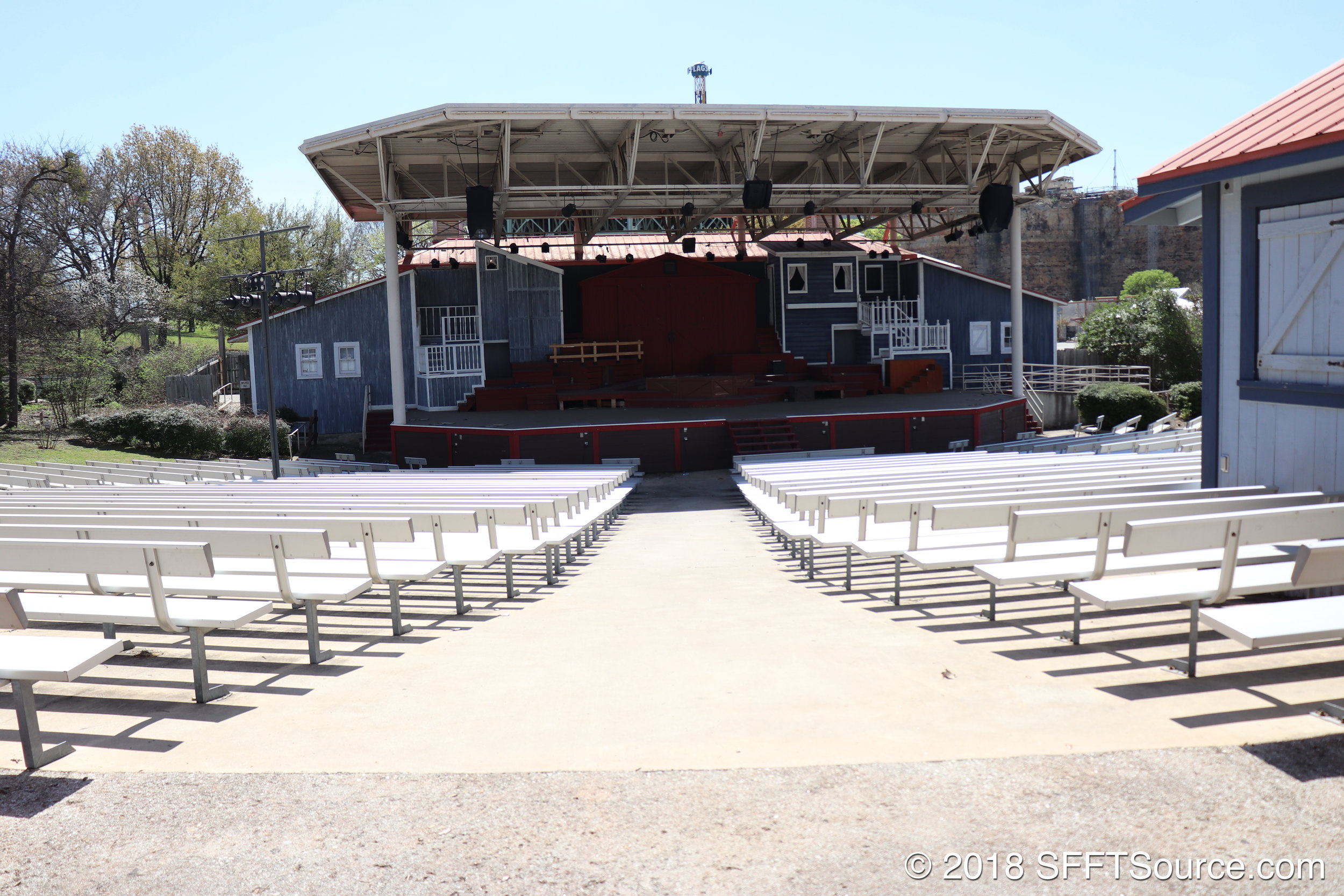 The venue features bench seating with backs.