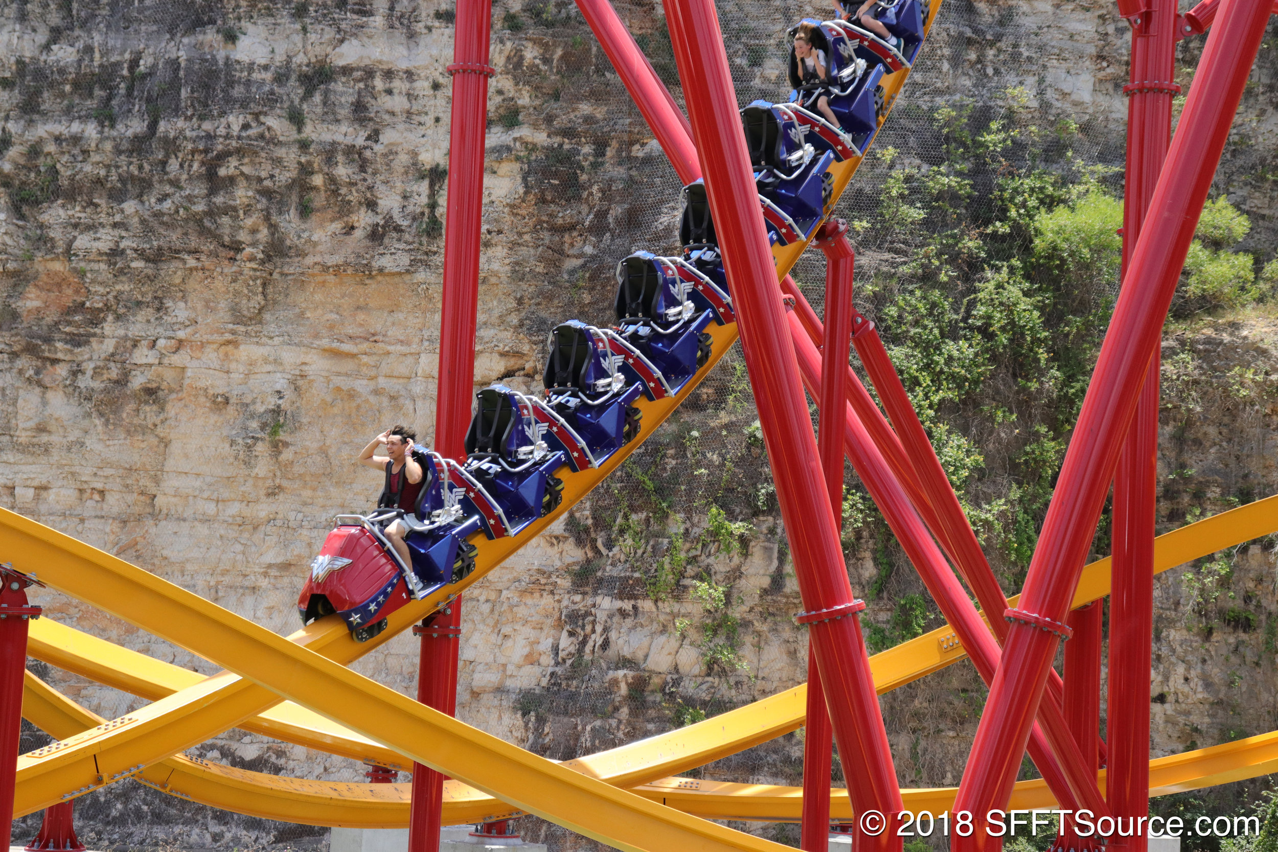 A train traveling down the bottom of the first drop.