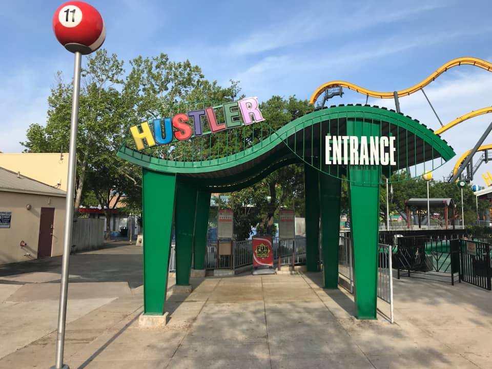The main entrance has been repainted, including the signage. One of the pool ball lamp covers can also be seen. Credit: Fiesta Texas