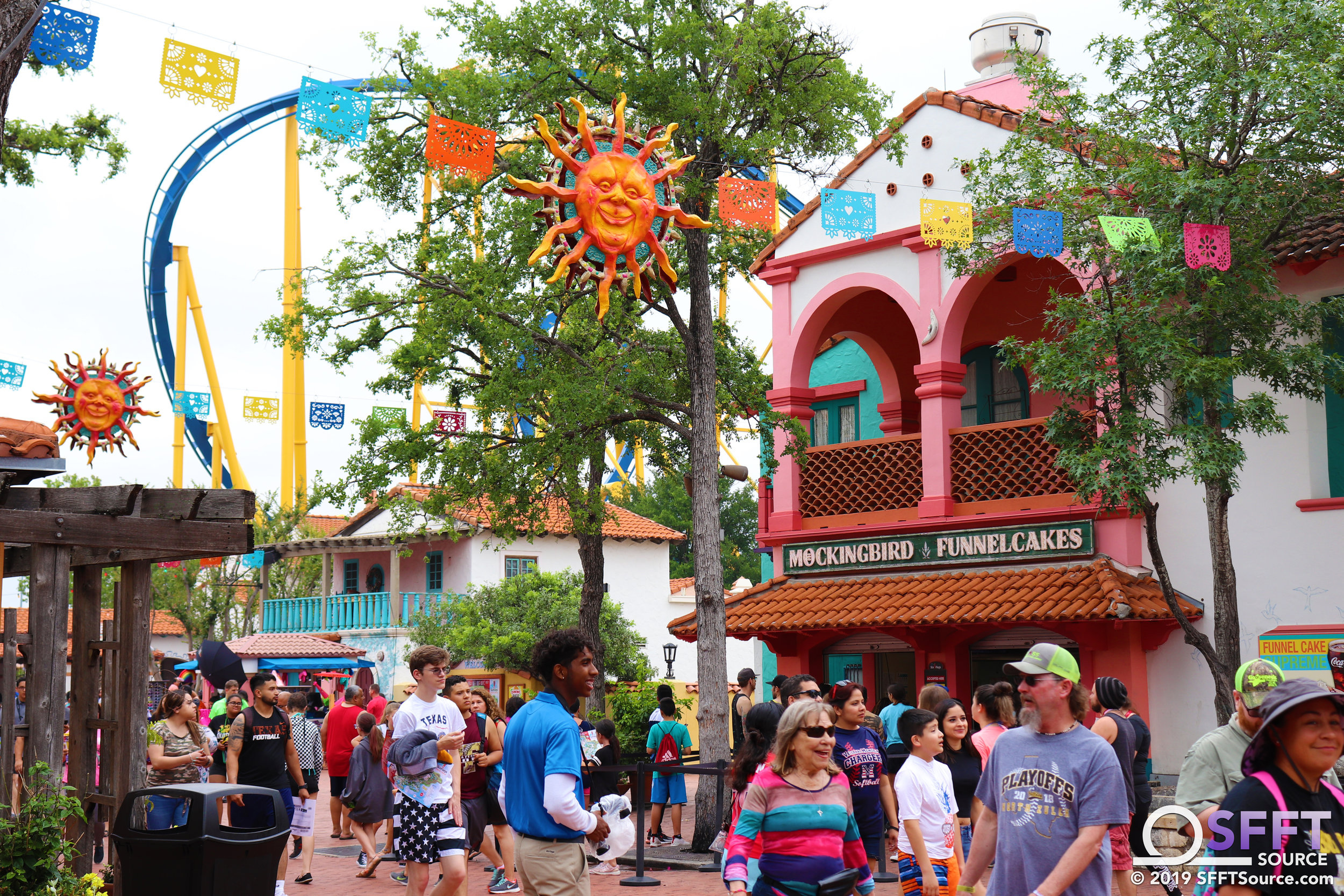 During summer, Los Festivales is decorated with festive suns and banners.