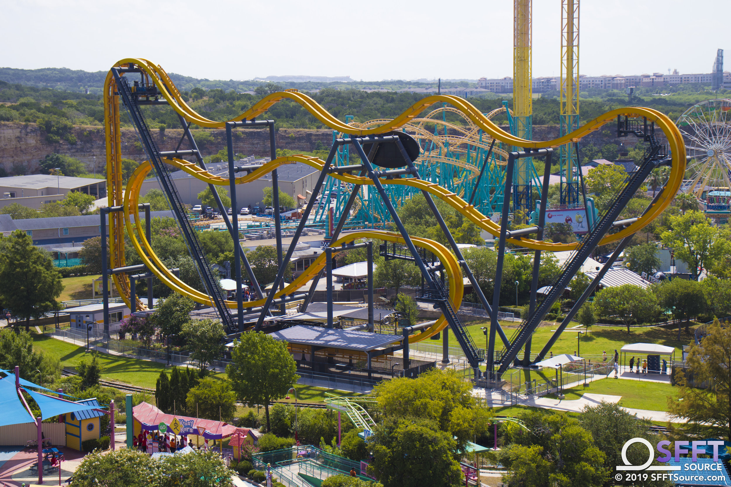A view of Batman: The Ride from atop the quarry wall.