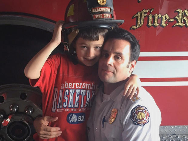 Ohio Firefighter Mike Palumbo and his son, Nicholas.  FAMILY PHOTO