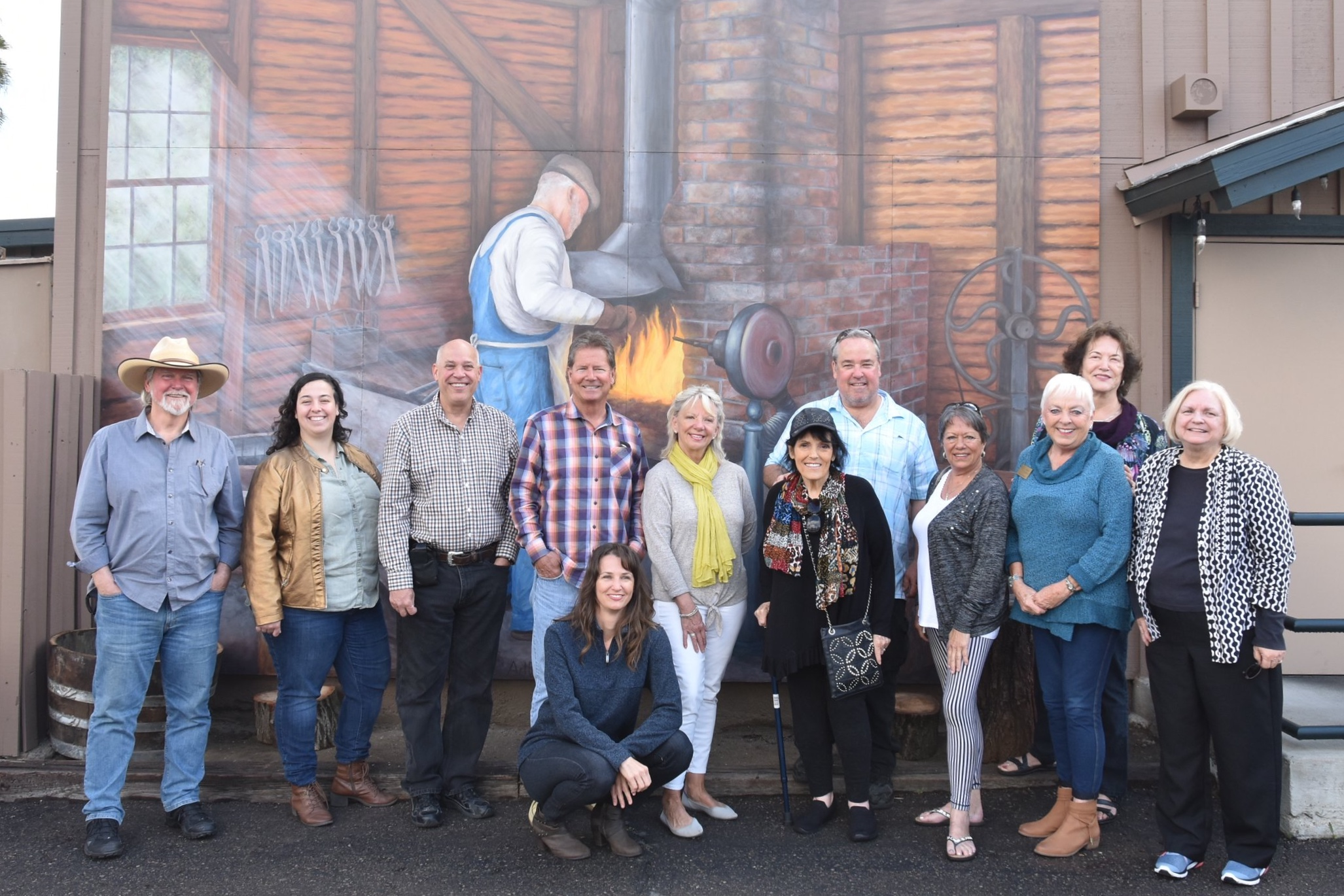 "Ramona H.E.A.R.T. Mural Project board members, artist Beata Wojick, D'Carlos Restaurant owners and guests celebrate the dedication of the ""Bandy Blacksmith"" mural.  Photo Courtesy of the Ramona H.E.A.R.T. Mural Project"