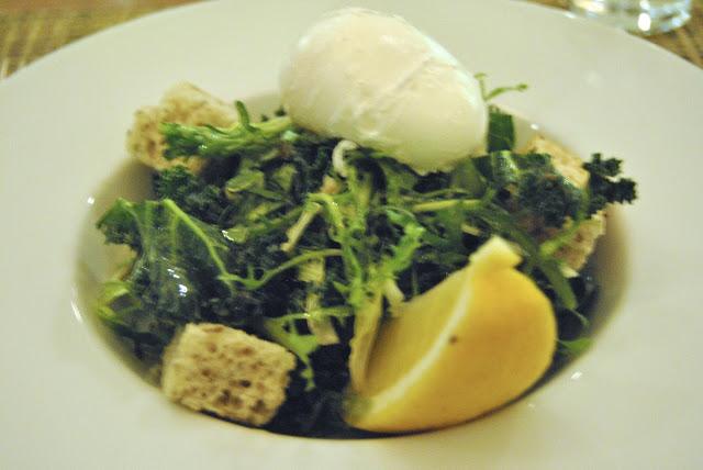 Kale  Caesar - kale and frisée, lemon vinaigrette, basil focaccia crouton, double smoked bacon, parmesan, poached egg