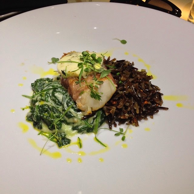 Pan Seared Cod  - Proscuitto wrapped, wild rice creamed spinach, lemon caper butter