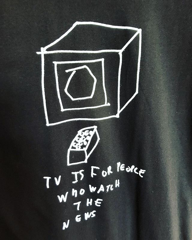 """... """"TV is for people who watch the news"""" T-shirts are still available in limited sized @bomb_diggity_arts 📺 Stop by the gallery to get yours!! #bombdiggity #bombdiggityarts #personfirst #allabilitieswelcome #tshirts #originalart #maineartists #we❤️art #maine #portland #congressstreet #tshirtdesigns #art #create #communitysupport"""