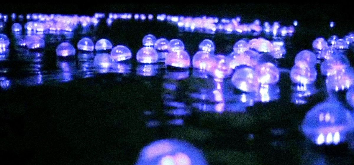"""DurIng operation """"Rios de Luz"""" (rivers of light), army and family members dropped clear plastic balls that were lit up and filled with messages and gifts up river from farc encampments, with the goal of letting farc members know that their families were waiting for them to celebrate christmas together."""