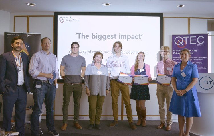 QSUW came to a close with an afternoon of business pitches, hosted at the beautiful offices of    TLT Solicitors    in Bristol. Our team picked up the award for the idea with 'the biggest impact', shown here squinting into the light of the projector, alongside the judging panel.