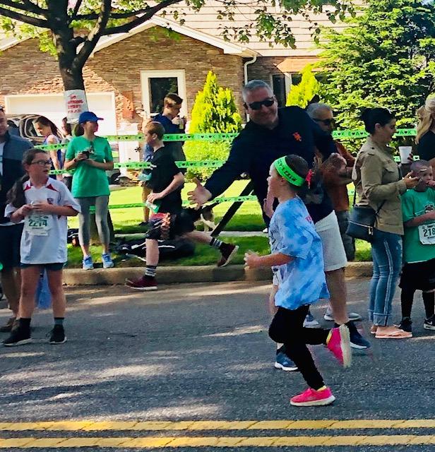Kasey running Emma's Mile