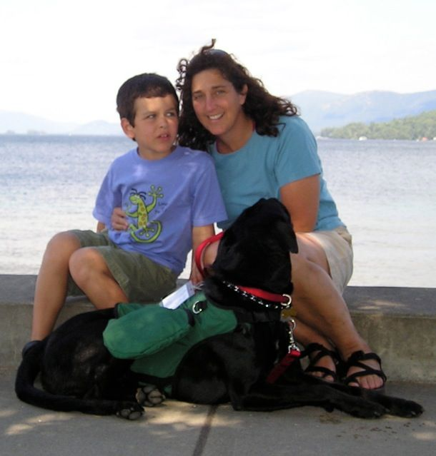 Ducan, Louie and Mom sitting next to a lake in Vermont