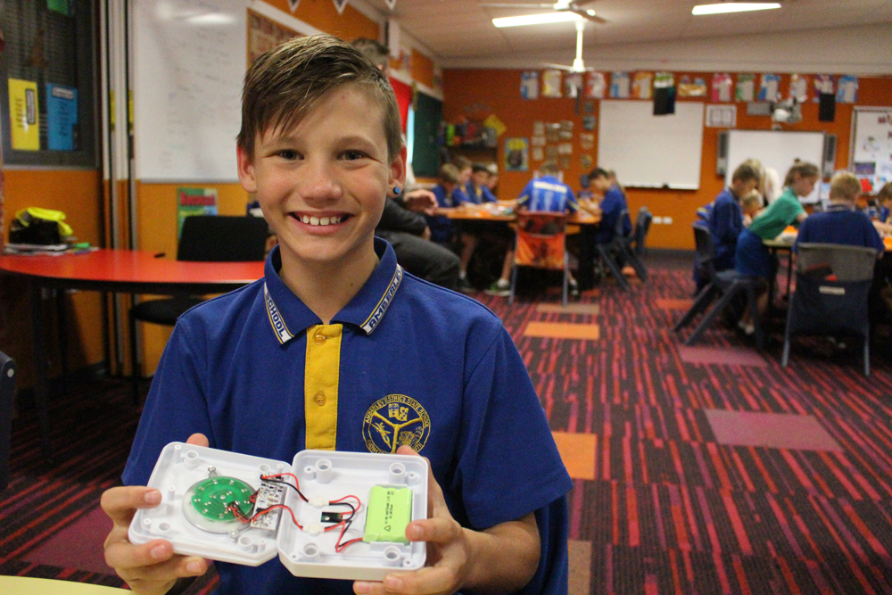 """A proud student in Australia after having assembled his SolarBuddy light. When asked how it made him feel taking part in our education program, he explained that """"It feels amazing to know that this light I have built will make someone else's life so much better""""."""
