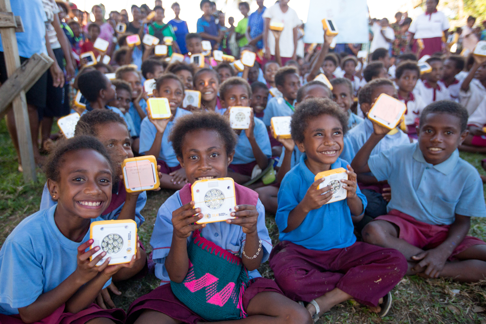 Happy faces all round in PNG after receiving their SolarBuddy lights.
