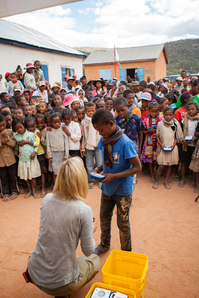 The SolarBuddy team giving lights to students in remote Madagascar.