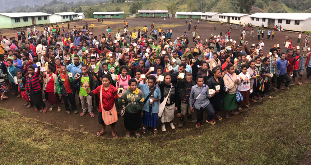 Students in PNG gather to celebrate receiving their SolarBuddy lights.