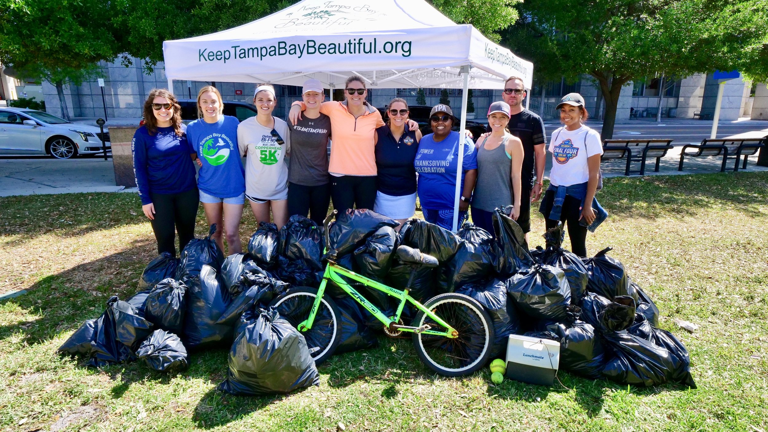 Local volunteers removed 40+ bags of trash from outdoor public spaces along the walking paths connecting the 2019 Women's Final Four Tourney Town fan festival with Amalie Arena the week before the tournament. (Photo: Tampa Bay Local Organizing Committee)