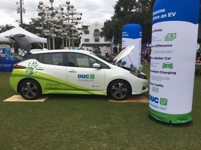 Title sponsor OUC The Reliable One setup an electric vehicle (EV) display at the 2018 Orlando Half Marathon to educate passerby about how they work.