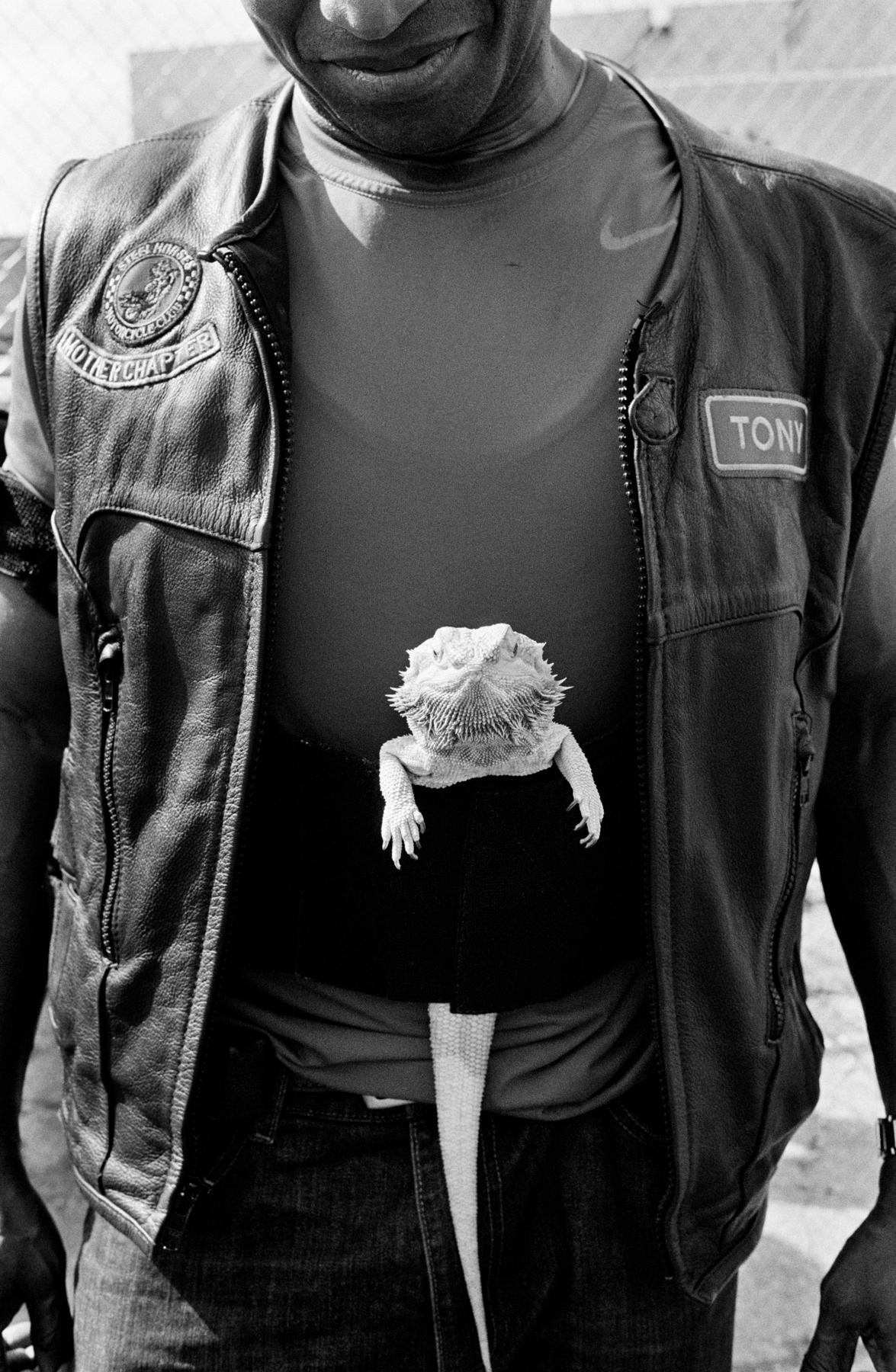 Tony of Steel Horses MC and Lizzy the bearded dragon about to ride out, The Bronx, 2016