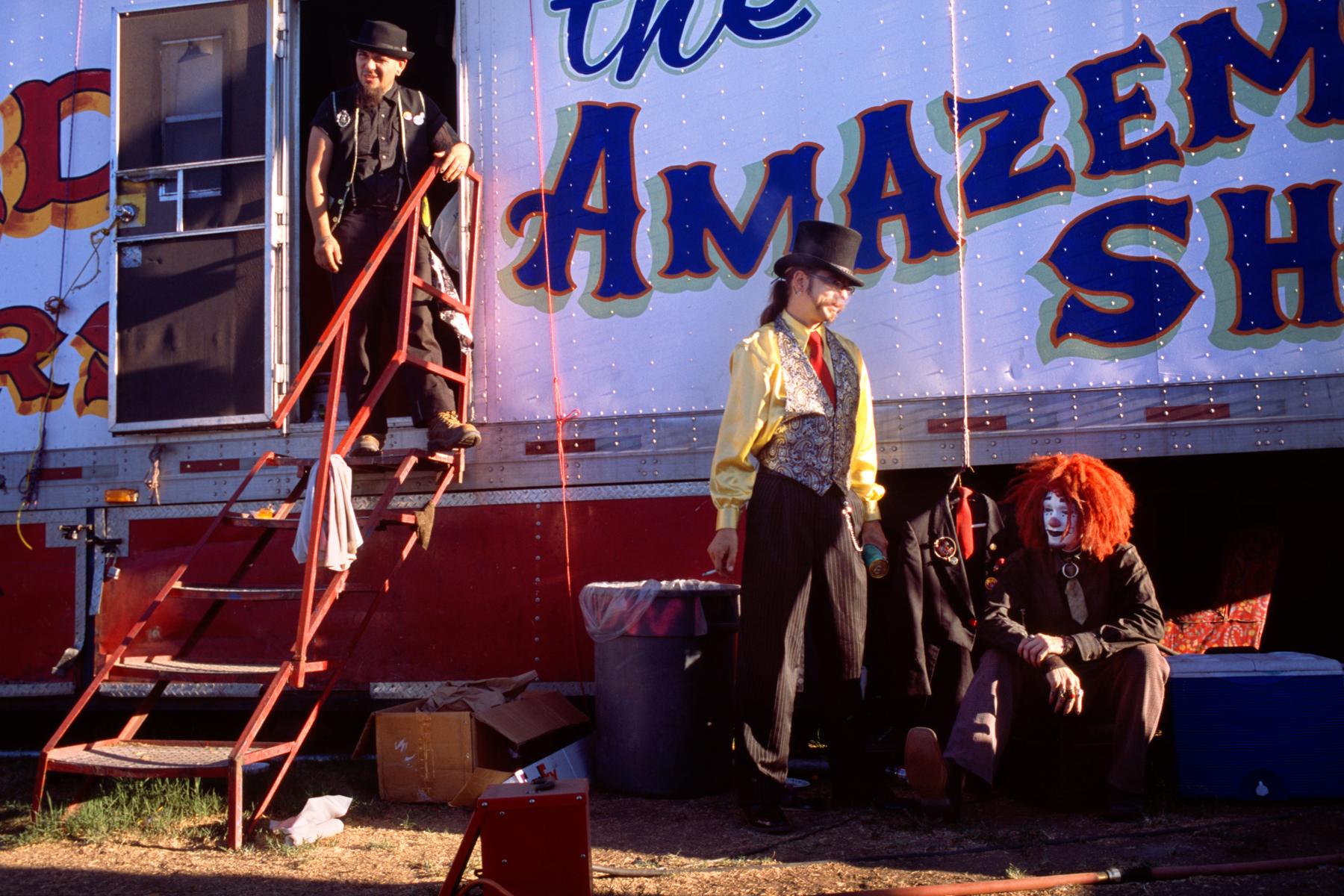 Whodini, Doc Tetanus, and Rash le Clown take a break behind the trailer