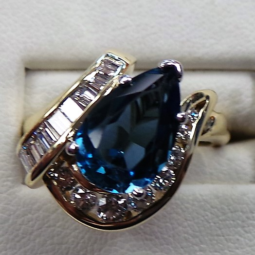 Original ring with thin shank and prong set blue topaz