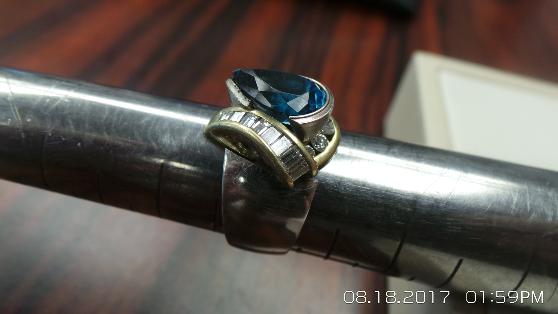 This is the mock up with the customized half bezel holding the blue topaz stone