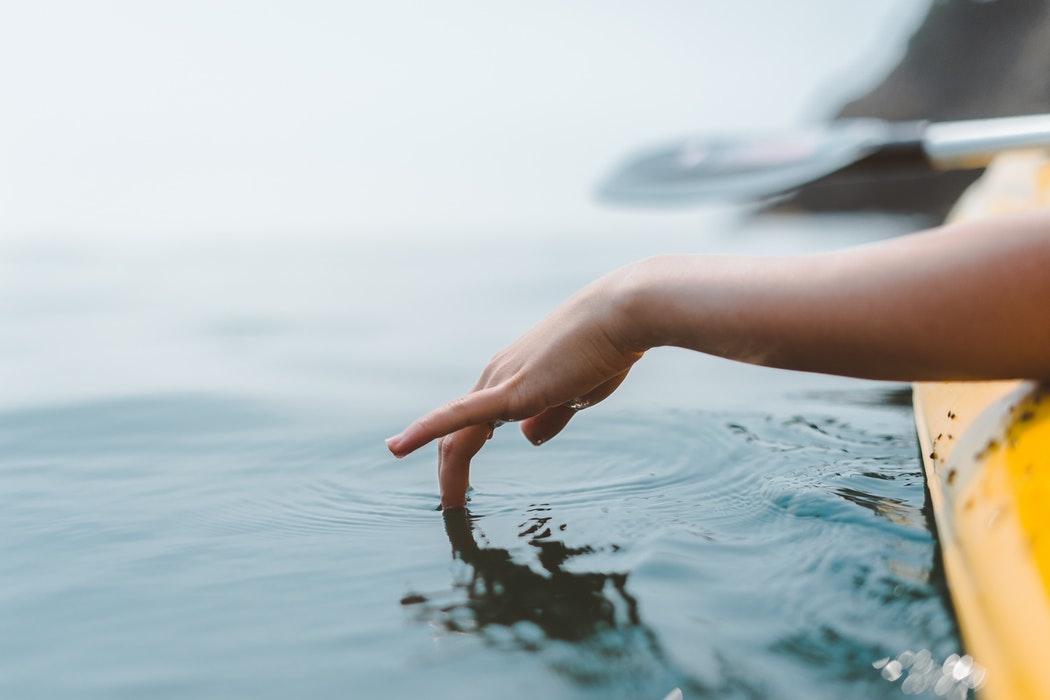 Kayaker touching water.jpg
