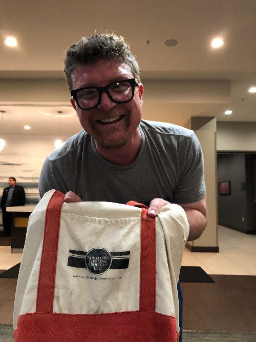 Dr. Ryan Kennedy of the John Hopkins Bloomberg School of Public Health shows the canvas bag that he used to conceal the instrument that he used to measure emissions while aboard Carnival Corporation ships.