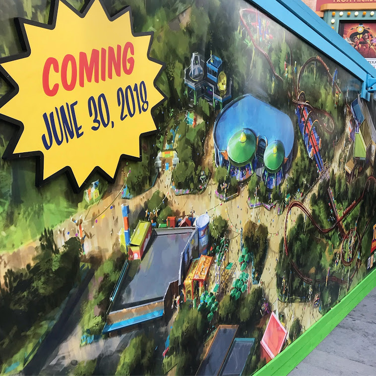 The walls (here detailing the concept art for Toy Story Land) officially came down for the Land's dedication ceremony on June 29, 2018 at Disney's Hollywood Studios.