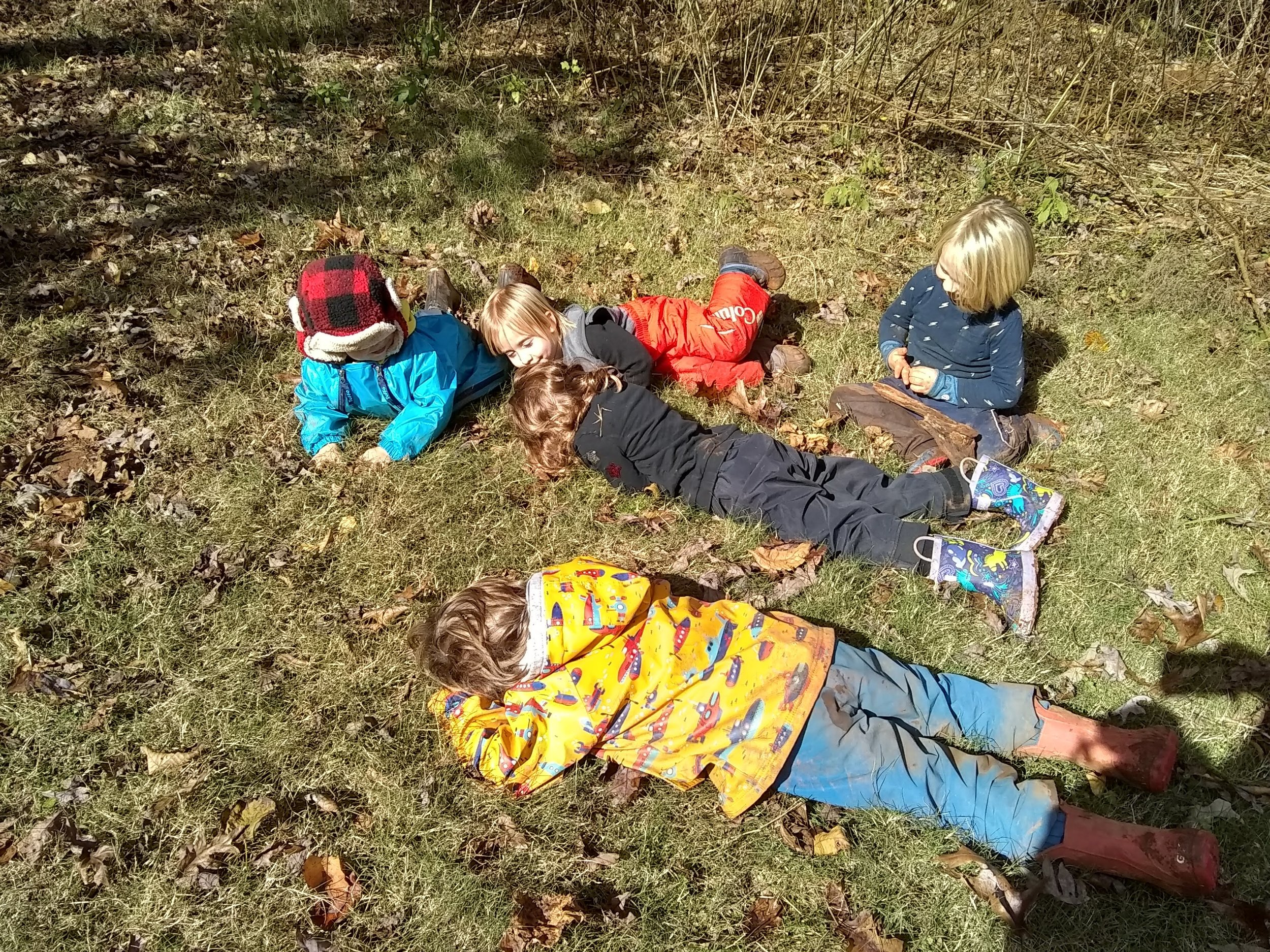 """The children instinctively """"recharged their batteries"""" in the warm sun after a morning in the shady, cool forest!"""