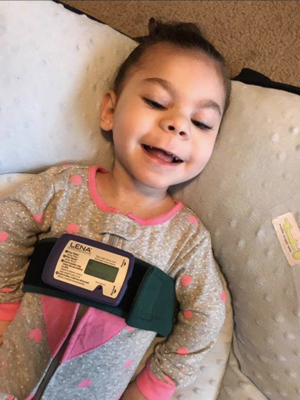 Makenna Loyd, wearing the LENA audio recording device.
