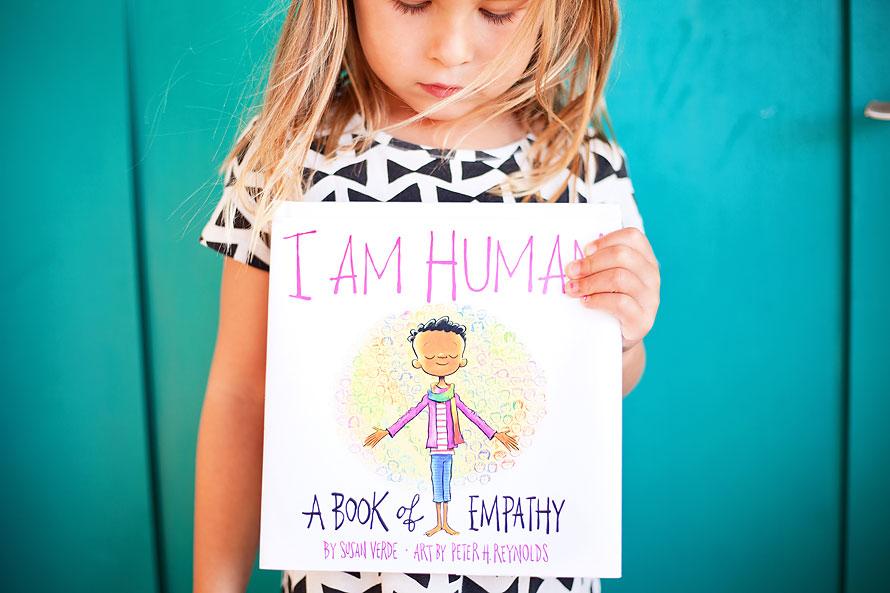 little-girl-holding-book-I-am-human-a-kidartlit-book-by-international-brand-photographer-brandilyn-davidson-in-2019.jpg