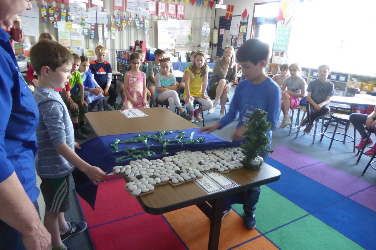 Mrs. Ross' class training for the beach day by modeling a healthy beach for forage fish spawning.
