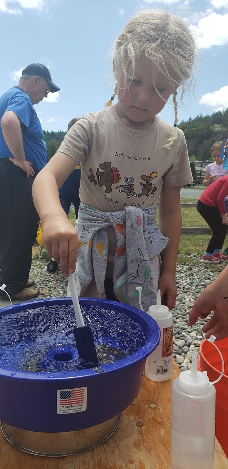Stirring eggs and sand so that the lighter eggs float to the top and the sand gets washed away.