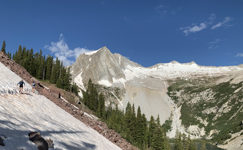 The snowy traverse following Snowmass Lake.