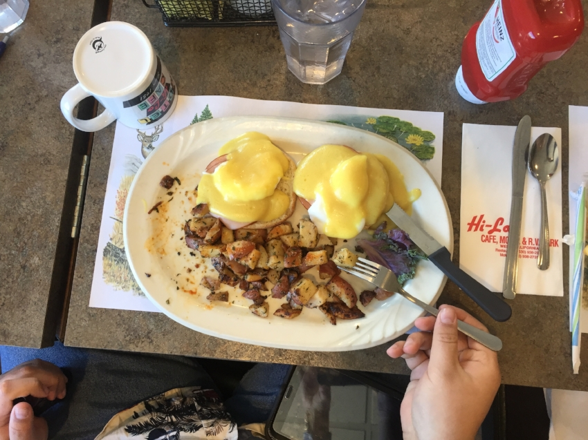 Maria ordered the traditional eggs Benedict with home fries.
