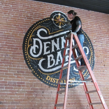 Mimi painting Denny sign.JPG