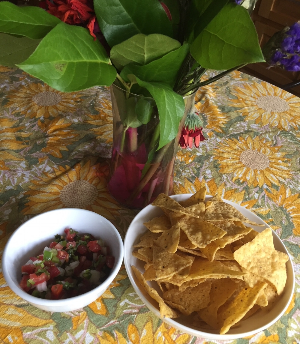 Fresh spicy Pico de Gallo on a crispy salty tortilla chip is a perfect snack.