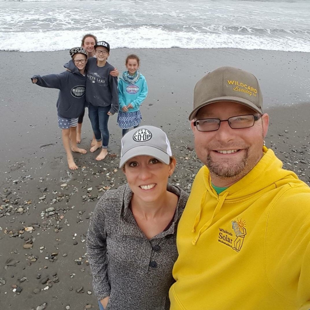 Kirstin and her family having fun on the beach