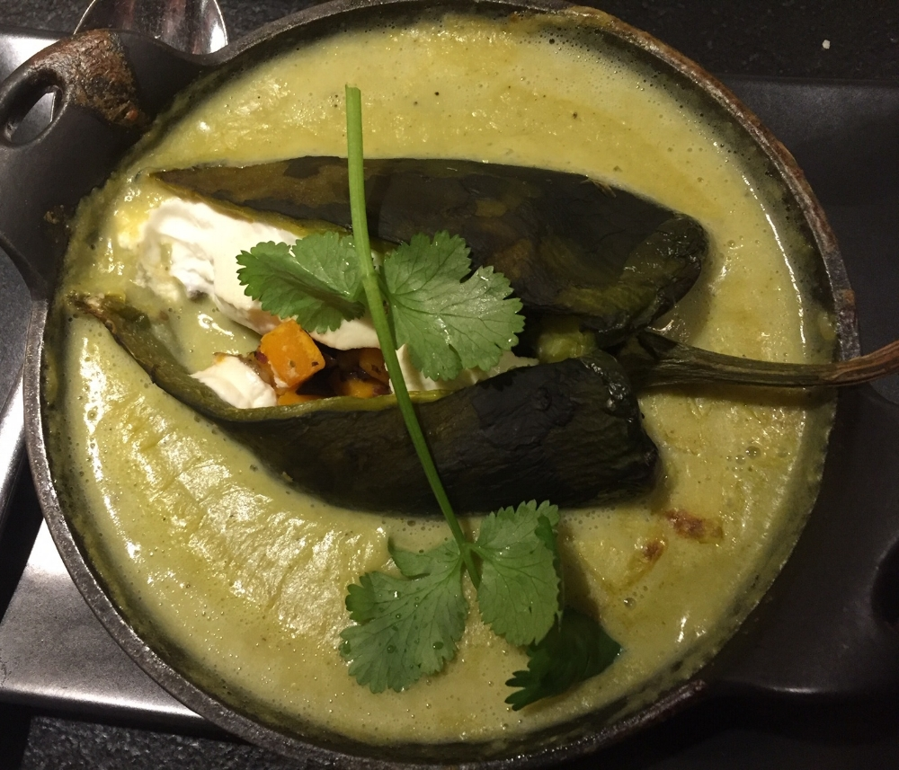 The Chile Relleno is rich in flavor and beautifully plated in Mexican pottery.